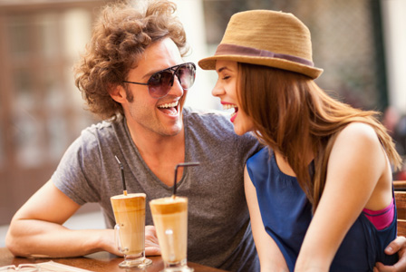 couple-laughing-in-cafe-horiz